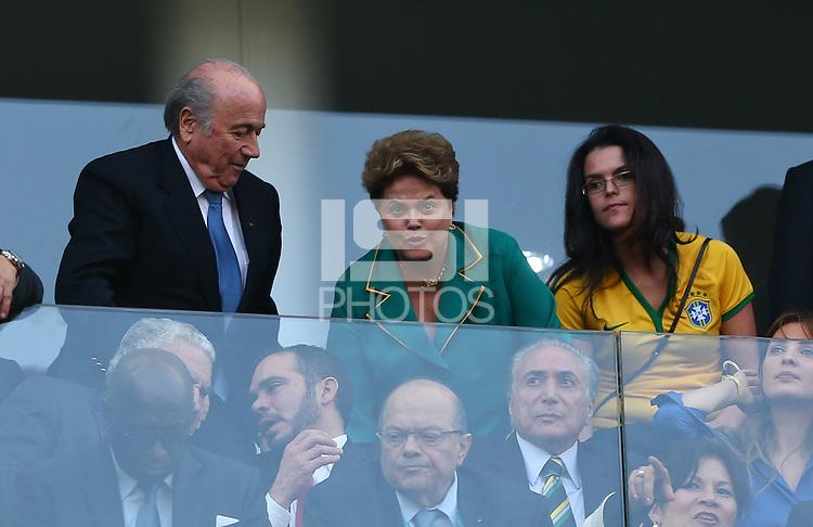 FIFA president Sepp Blatter takes his seat next to Brazilian president Dilma Rousseff