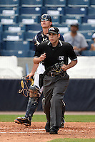 Home plate umpire Jordan Albarado and catcher Peter O'Brien (24) watch a fly ball during a game between the Daytona Cubs and Tampa Yankees on April 13, 2014 at George M. Steinbrenner Field in Tampa, Florida.  Tampa defeated Daytona 7-3.  (Mike Janes/Four Seam Images)