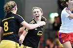 Mannheim, Germany, January 24: Anne-Kathrin Deupmann #21 of Harvestehuder THC celebrates after scoring the winning goal during the 1. Bundesliga Damen Hallensaison 2014/15 quarter-final hockey match between Mannheimer HC (white) and Harvestehuder THC (black) on January 24, 2015 at Irma-Roechling-Halle in Mannheim, Germany. Final score 2-3 (2-2). (Photo by Dirk Markgraf / www.265-images.com) *** Local caption *** Anne-Kathrin Deupmann #21 of Harvestehuder THC