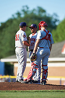 Auburn Doubledays pitching coach Tim Redding (17) talks with starting pitcher Nick Raquet (32) and catcher Nic Perkins (43) during a game against the Batavia Muckdogs on July 4, 2017 at Dwyer Stadium in Batavia, New York.  Batavia defeated Auburn 3-2.  (Mike Janes/Four Seam Images)
