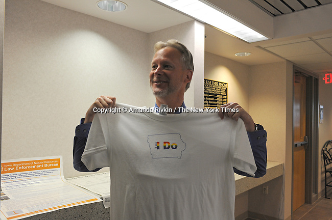 Reverend Rich Hendricks, 50, of Davenport, Iowa was the first in line to pick up his marriage license at the Scott County Recorder's Office the first day same sex weddings are legal across Iowa in Davenport, Iowa on April 27, 2009.  He holds up a T-shirt he procured from a supporter in the parking lot outside the county building.