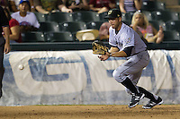 Omaha Storm Chasers third baseman Anthony Seratelli #2 fields a ground ball during the Pacific Coast League baseball game against the Round Rock Express on July 22, 2012 at the Dell Diamond in Round Rock, Texas. The Express defeated the Chasers 8-7 in 11 innings. (Andrew Woolley/Four Seam Images).