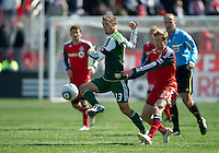 26 March 2011: Portland Timbers midfielder Jack Jewsbury #13 and Toronto FC midfielder Jacob Peterson #23 in action during an MLS game between the Portland Timbers and the Toronto FC at BMO Field in Toronto, Ontario Canada....