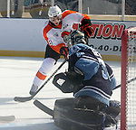 OMAHA, NE - FEBRUARY 9:  Robbie Baillargeon #18 from the Omaha Lancers flips the puck past Michael Bitzer #33 from the Lincoln Stars for a goal in the first period at the Battle on Ice Saturday at TD Ameritrade in Omaha, NE. (Photo by Schyler Eggen/Inertia)
