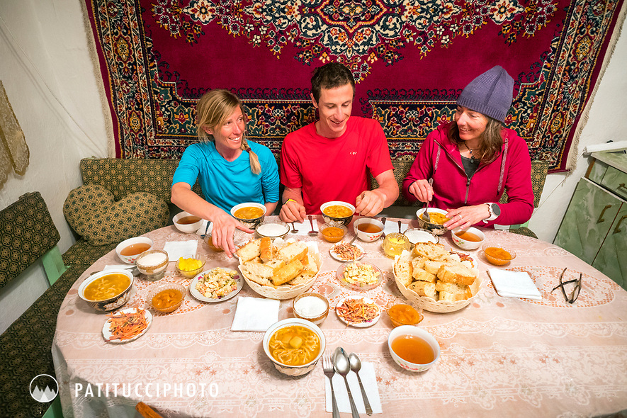 Travelers eating at a private home in Kyrgyzstan