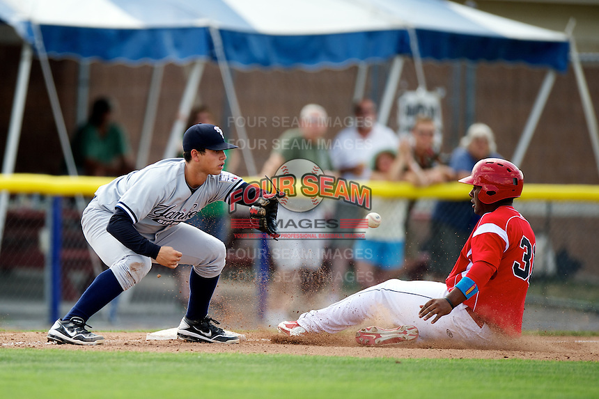 Staten Island Yankees Matt Duran #20 takes a throw as Roberto De La Cruz #31 slides in during a game against the Batavia Muckdogs at Dwyer Stadium on July 29, 2012 in Batavia, New York.  Batavia defeated Staten Island 10-2.  (Mike Janes/Four Seam Images)