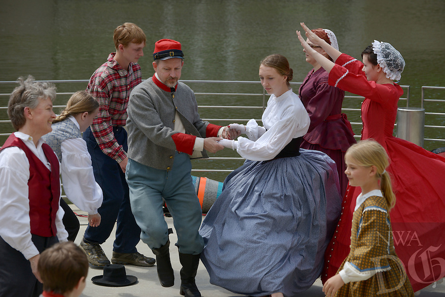 NWA Democrat-Gazette/BEN GOFF @NWABENGOFF<br /> The Heritage School Dancers from the Washington County Historical Society perform an American folk dance on Sunday April 24, 2016 during the 'El Dia de los Ninos' event at Crystal Bridges Museum of American Art in Bentonville. El Dia de los Ninos, or Children's Day, is a hispanic tradition, but the event included dance, musical and crafts highlighting a variety of cultures and children's creativity.