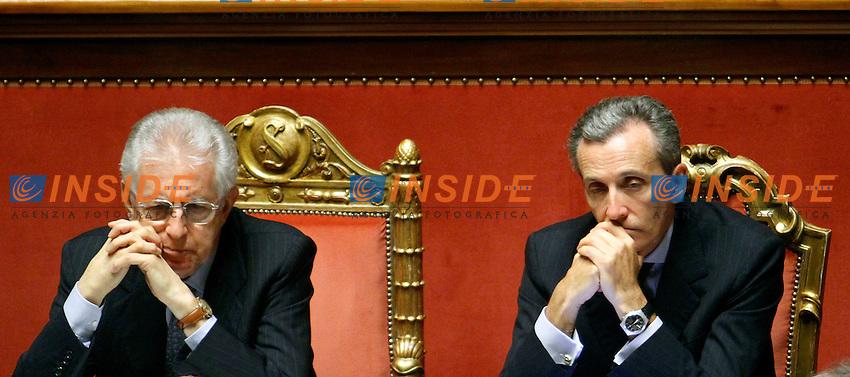 Mario Monti e Vittorio Grilli.Roma 03/07/2012 Senato. Informativa del Premier sull'esito del Vertice di Bruxelles..Photo Samantha Zucchi Insidefoto