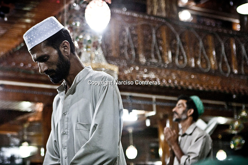 Kashmri muslim men praying at a shrine after broke ther fasting in Srinagar as the main duty to observe the holy month of Ramadan. As the tradition is attended muslims has to fast from dawn to dusk, where they refrain from eating, drinking and smoking..