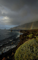 Rainbows over rocky coastline, Roques del Samor,El Hierro, Canary Islands, Spain.