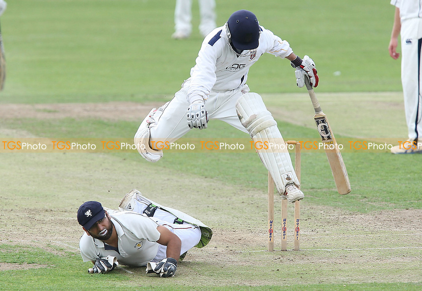 F Butt tries to make a diving stop for Ardleigh Green, forcing Y Patel to hurdle him - Ardleigh Green CC vs Hainault & Clayhall CC - Essex Cricket League at Central Park - 08/08/09 - MANDATORY CREDIT: Gavin Ellis/TGSPHOTO - Self billing applies where appropriate - Tel: 0845 094 6026