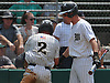 Ryan Murphy #11 of Wantagh, right, congratulates Mason McLane #2 after he crossed home plate in the bottom of the first inning of the Nassau County varsity baseball Class A final against Division Avenue at SUNY Old Westbury on Saturday, May 26, 2018. McLane delivered a two-run single in frame to extend Wantagh's lead to 3-0 as the Warriors went on to win Game 1 of the best-of-three series by a score of 5-2.