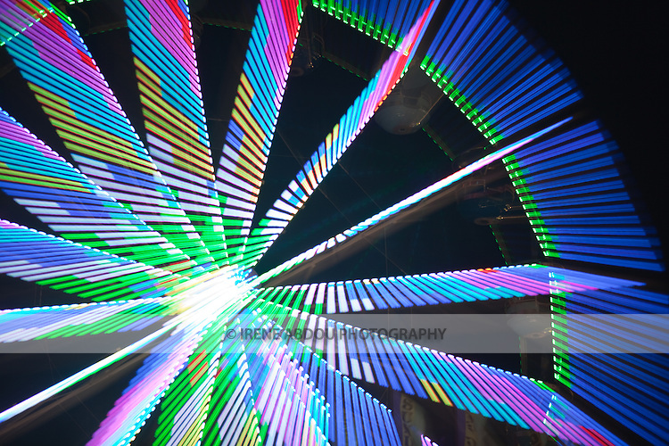 "A photography technique called ""zoom blur"" is used to transform the lights of the ferris wheel into abstract designs at the Montgomery County Agricultural Fair in Gaithersburg, Maryland."