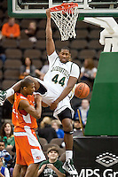 February 25, 2010:     Jacksonville center Glenn Powell (44) completes a dunk over a Campbell player during Atlantic Sun Conference action between the Jacksonville Dolphins and the Campbell Camels at Veterans Memorial Arena in Jacksonville, Florida.  Jacksonville defeated Campbell 65-52.