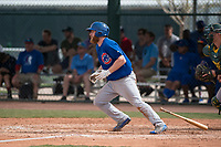 Chicago Cubs third baseman Jesse Hodges (19) starts down the first base line during a Minor League Spring Training game against the Oakland Athletics at Sloan Park on March 13, 2018 in Mesa, Arizona. (Zachary Lucy/Four Seam Images)