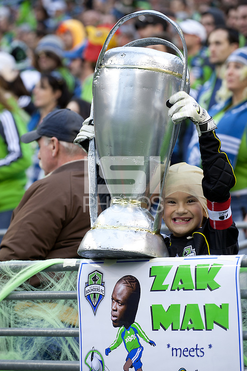 A fan dressed for Halloween displays his own US Open Cup before the first game of the 2010 MLS Playoffs between the Seattle Sounders and the Los Angeles Galaxy at the XBox 360 Pitch at Quest Field in Seattle, WA on October 31, 2010. The Galaxy defeated the Sounders 1-0.