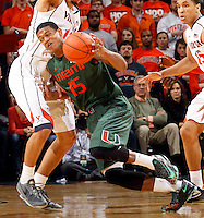 Miami guard Rion Brown (15)is fouled by Virginia forward Anthony Gill (13) during an NCAA basketball game Saturday Feb, 24, 2014 in Charlottesville, VA. Virginia defeated Miami 65-40.