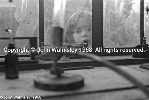 Looking in the Science room window, Summerhill school, Leiston, Suffolk, UK. 1968.