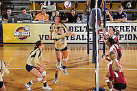 17 November 2011:  FIU middle blocker Silvia Carli (9) saves a shot in the first set as the FIU Golden Panthers defeated the Denver University Pioneers, 3-1 (25-21, 23-25, 25-21, 25-18), in the first round of the Sun Belt Conference Tournament at U.S Century Bank Arena in Miami, Florida.