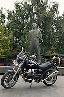 Moscow, Russia, 12/08/2013.<br /> Moto Guzzi Bellagio statue of Lenin behind.