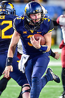 Morgantown, WV - NOV 19, 2016: West Virginia Mountaineers quarterback Skyler Howard (3) scores a touchdown late in the fourth quarter during game between West Virginia and Oklahoma at Mountaineer Field at Milan Puskar Stadium Morgantown, West Virginia. (Photo by Phil Peters/Media Images International)