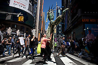 NEW YORK, NY - MAY 01: People walk during a march for immigrant worker rights as part of May Day rallies on May 1, 2013 in New York City. Rallies and marches are occuring throughout the city today to mark the day which is traditionally associated with workers movements. (Photo by Kena Betancur).
