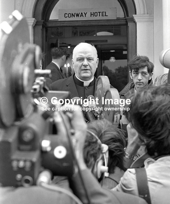 Cardinal Conway, Roman Catholic Archbishop of Armagh, Primate of All Ireland, is interviewed by journalists and television camera crews, following his meeting with UK Home Secretary, Reginald Maudling, who is on a two-day visit to N Ireland. 197007010241a.<br />