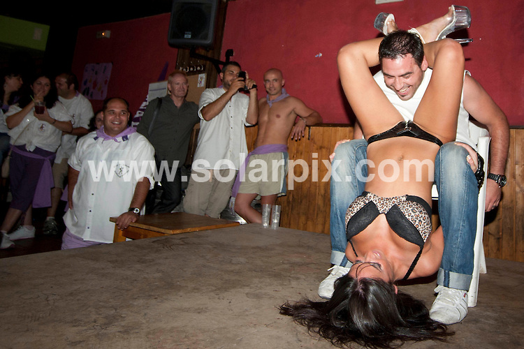 **ALL ROUND PICTURES FROM SOLARPIX.COM**                                             **WORLDWIDE SYNDICATION RIGHTS EXCEPT SPAIN - NO SYNDICATION IN SPAIN**                                                                                  Caption: Traditional annual striptease at the San Bartolome Fair, Organised by the Juglar Club at the Bar Delorean - headquarters of the Juglar Club, San Bartolome Fair 2011, Alcala de Henares, Madrid, Spain. 26 August 2011                                                                             This pic: San Bartolome Striptease                                                                                             JOB REF: 13895 DMS Dolores      DATE: 26_08_2011                                                           **MUST CREDIT SOLARPIX.COM OR DOUBLE FEE WILL BE CHARGED**                                                                      **MUST AGREE FEE BEFORE ONLINE USAGE**                               **CALL US ON: +34 952 811 768 or LOW RATE FROM UK 0844 617 7637**