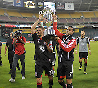 Dwayne De Rosario (7) and Perry Kitchen (23) of D.C. United presenting the U.S. Open Cup Trophy to the fans at  the end of the game.  The Chicago Fire defeated D.C. Untied 3-0, at RFK Stadium, Friday October 4 , 2013.