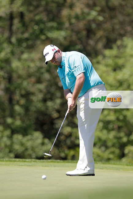 Shane Lowry (IRL) putts on the 7th green during Thursday's Round 1 of the 2014 Open de Espana held at the PGA Catalunya Resort, Girona, Spain. Wednesday 15th May 2014.<br /> Picture: Eoin Clarke www.golffile.ie