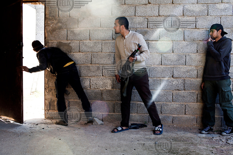 Rebel fighters move from house to house, back street by back street in Misurata to fire on Gaddafi forces. On 17 February 2011 Libya saw the beginnings of a revolution against the 41 year regime of Col Muammar Gaddafi.