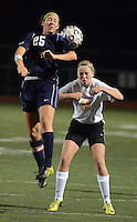 DOYLESTOWN, PA - OCTOBER 6: Council Rock South's Elissa Dotzman #25 heads the ball as Central Bucks West's Mary Kate Vinkler #19 defends in the first half at Central Bucks West October 6, 2014 in Doylestown, Pennsylvania. (Photo by William Thomas Cain/Cain Images)