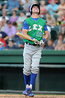 Outfielder Bubba Starling (11) of the Lexington Legends strikes out with the bases loaded and no outs in the third inning of a game against the Greenville Drive on Monday, July 22, 2013, at Fluor Field at the West End in Greenville, South Carolina. Starling is the No. 2 prospect of the Kansas City Royals and was the No. 5 overall pick in the first round of the 2011 First-year Player Draft. Lexington won, 7-3. (Tom Priddy/Four Seam Images)
