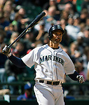 Seattle Mariners' Raul Ibanez watches his home run hit to center field against the Texas Rangers in the fourth inning April 14, 2013 at Safeco Field in Seattle.  © 2013. Jim Bryant Photo. All Rights Reserved.