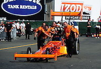 Jul. 29, 2011; Sonoma, CA, USA; Crew members push the car of NHRA top fuel dragster driver Mike Salinas during qualifying for the Fram Autolite Nationals at Infineon Raceway. Mandatory Credit: Mark J. Rebilas-