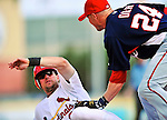 10 March 2010: St. Louis Cardinals' infielder Mark Hamilton is caught in a rundown and tagged out at third by Pete Orr during a Spring Training game against the Washington Nationals at Roger Dean Stadium in Jupiter, Florida. The Cardinals defeated the Nationals 6-4 in Grapefruit League action. Mandatory Credit: Ed Wolfstein Photo