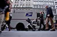The U.S. Postal Service is in the midst of its busiest two days of the year,This week,the service expects to deliver 16.5 billion pieces of mail over the holiday season meanwhile a potential bankruptcy is still affecting the U.S. Postal Service in New York, United States. 9/12/2011.  Photo by Kena Betancur / VIEWpress.