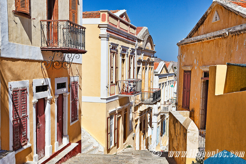 An alley with the colourful houses of the upper town (Chorio) of Symi island, Greece