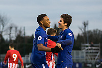 Goal scorer Juan Familio-Castillo (left) of Chelsea celebrates with Harvey St Clair during the UEFA Youth League group match between Chelsea and Atletico Madrid Juvenil A at the Chelsea Training Ground, Cobham, England on 5 December 2017. Photo by Andy Rowland.