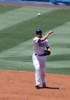 25th July 2020, Los Angeles, California, USA;  Los Angeles Dodgers shortstop Corey Seager (5) makes a throw to first base during the game against the San Francisco Giants on July 25, 2020, at Dodger Stadium in Los Angeles, CA.