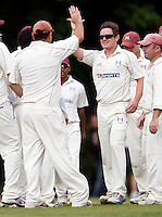 Tony Duckett (L) high fives Craig Gourlay after he dismissed a Bessborough player during the Middlesex County League Division Three game between Highgate and Bessborough at Park Road, Crouch End on Sat Sept 4, 2010