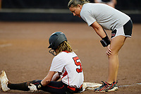 Sun Prairie head coach, Jamie Olson, talks to Grace Radlund, who is safe after stealing third base in the third inning. Oshkosh North goes on to top Sun Prairie 4-2 in nine innings to win the championship game of the 2019 Division 1 Wisconsin WIAA girls state high school softball tournament on Saturday, June 8, at Goodman Diamond in Madison, Wisconsin