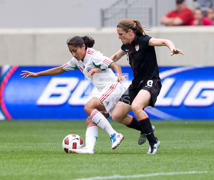 Heather O'Reilly (9) of the USWNT  stays tight to Fany Mayor (21) of Mexico during the game at Red Bull Arena in Harrison, NJ.  The USWNT defeated Mexico, 1-0.