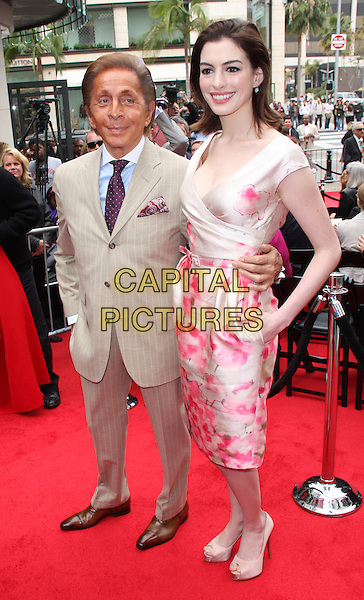 VALENTINO & ANNE HATHAWAY.Designer Valentino to be Inducted into the Rodeo Drive Walk of Style on Rodeo Drive, Beverly Hills, California, USA, .2nd April 2009..Garavani full length pink and cream beige floral print dress silk satin shoes heels pinstripe beige suit peep toe platforms blue shirt tie .CAP/ADM/KB.©Kevan Brooks/Admedia/Capital PIctures