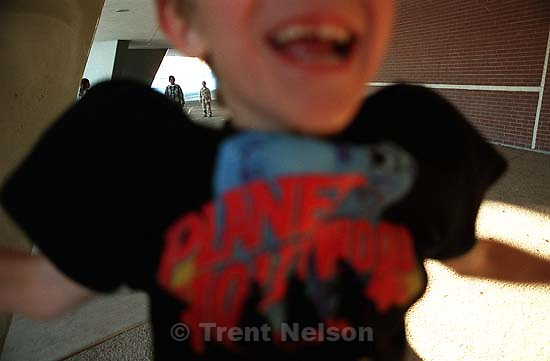 Kid (Grant Hedding) jumps in front of my camera while shooting the after-school care program at Dee Elementary School.<br />