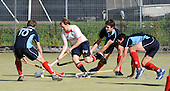 Scottish Hockey League - Western Wildcats V Grange HC at Auchenhowie, Milngavie - Western's forward Dougie Simpson (in white) tries to find a way through the Grange defence - l to r  Gary Cameron, George Lambert, and Robert Barr - the match ended 3-3 - picture by Donald MacLeod 25.09.10 - mobile 07702 319 738 - clanmacleod@btinternet.com - www.donald-macleod.com