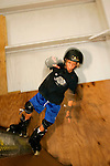 In-line skater Jack Kaplan, 8, of Long Beach, New York, skates the mini ramp in Lot 8 at Camp Woodward in Woodward, Pennsylvania.  August 8, 2005.