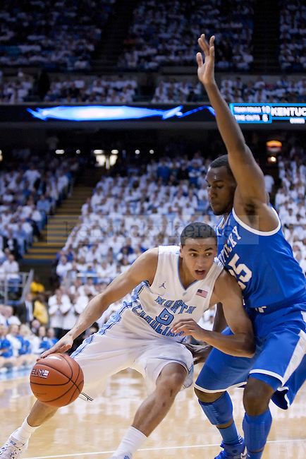 Kentucky Wildcats guard Dominique Hawkins (25) guards North Carolina Tar Heels guard Marcus Paige (5) as he attempts to shoot a layup during the UK men's basketball vs. North Carolina at the Dean Smith Center in Chapel Hill, N.C., on Saturday, December 14, 2013. Photo by Emily Wuetcher | Staff