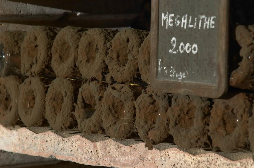 Bottles aging in the cellar. Megalithe 2000 Domaine de la Perriere, Sancerre, Loire, France