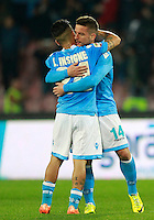 Calcio, Serie A: Napoli vs Juventus. Napoli, stadio San Paolo, 30 marzo 2014. <br /> Napoli forward Lorenzo Insigne, left, hugs teammate Dries Mertens, of Belgium, at the end of the Italian Serie A football match between Napoli and Juventus at Naples' San Paolo stadium, 30 March 2014. Napoli won 2-0.<br /> UPDATE IMAGES PRESS/Isabella Bonotto